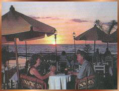 Couple dining at sunset.